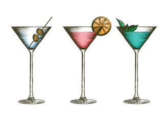 Martini glasses with olives, citruses and leaves of mint. Glass goblets with colorful cocktails in engraved style.
