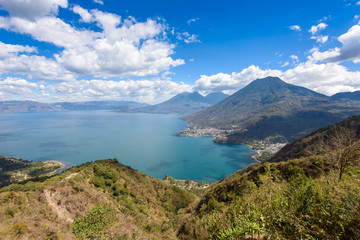 Viewpoint at lake Atitlan with the three volcanos San Pedro, Atitlan and Toliman - you can see the small villages San Pedro and San Juan at the lake in the highlands of Guatemala