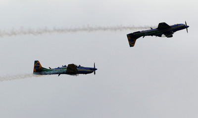 Brazilian Air Force pilots on Super Tucano airplanes perform aerobatics during the F-Air Colombia 2017 air festival in Rionegro
