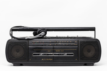 old cassette player and headphones isolate on white background.