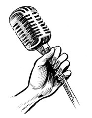 Hand holding a retro microphone