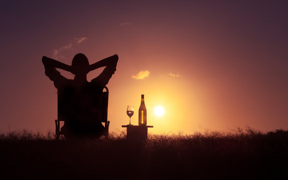 Peace of mind. Woman sitting back relaxing in a beautiful peaceful nature setting.