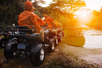 atv sport vehicle team ready to adventure in mud track