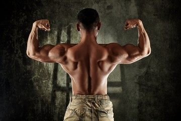 Male bodybuilder showing back muscles