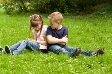 girl and boy. small children spend time in nature.