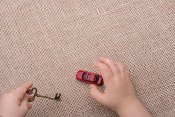 Toy car as a transportation devices in hand