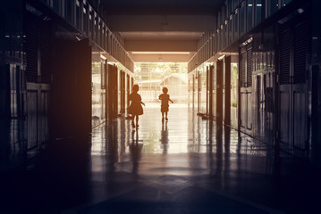 silhouette image of Happy kid in school.