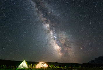 camp in mountain with under starry night sky with  Milky Way