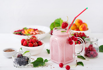 Yoghurt-strawberry smoothies in a jar on a white background