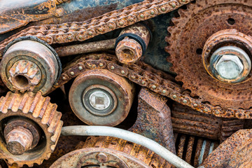corroded old gear wheels of broken industrial machine closeup
