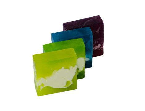 New soap. Colorful pieces of soap. Isolated over white background