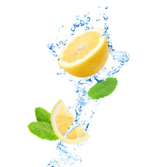 Splashing water with lemon and mint on white background