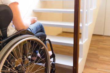 Person in a wheelchair in front of a stair
