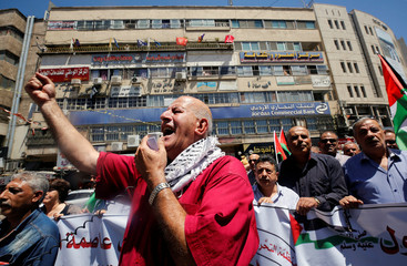 Palestinian protesters chant slogans during a demonstration against the recent closure of the Al-Aqsa Mosque, in Nablus