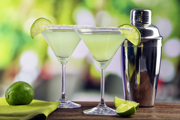 Delicious margarita cocktails on table