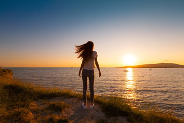 Sea summer. Sunset. Back