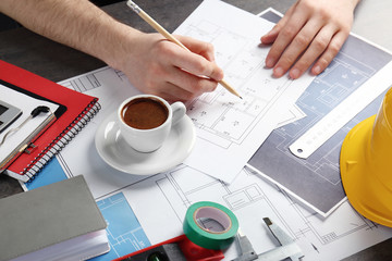 Engineer working at table with drawings