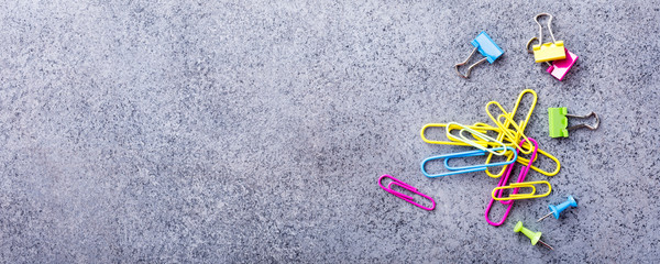Background with assorted colorful school supplies on gray stone table. Concept with copy space.