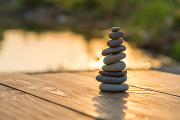 Zen Balancing Pebbles Next to a Misty Lake Wall mural