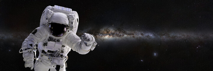 Astronaut, space walk in front of the Milky Way galaxy