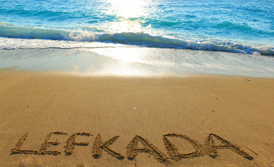 Lefkada written on sandy beach in Greece