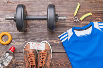 Workout equipment for professional bodybuilder. Muscle strength with weight lifting.