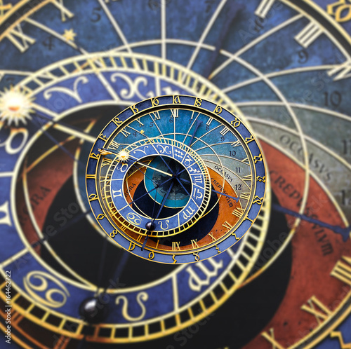 Wall mural Old astronomical clock isolated on white. Prague astronomical clock at the Old Town City Hall from 1410 is the third oldest astronomical clock in the world