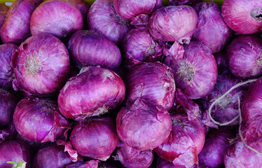 Purple onions for sale at the rural market