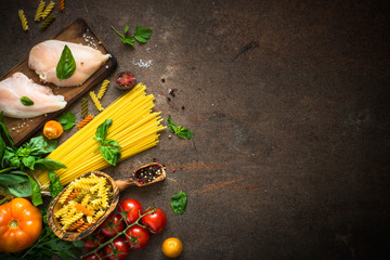 Italian food background. Pasta, meat and vegetables. Top view.