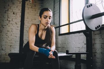 Young woman having some rest after hard workout in gym.
