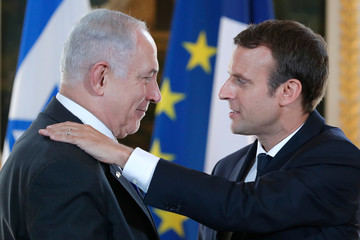 French President Emmanuel Macron and Israeli Prime Minister Benjamin Netanyahu react after making a joint declaration at the Elysee Palace in Paris