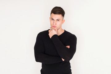 Confident young man studio portrait, boy style