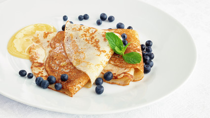 dessert crepes with honey and bilberry