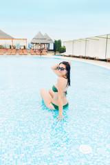 Woman enjoys on the swimming pool