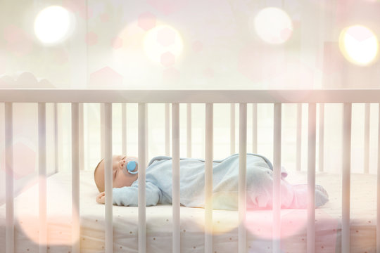 Cute little baby sleeping in cradle at home