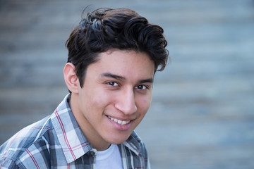 Teenage Hispanic boy, smiling