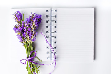 Lavender flowers bouquet on open notebook