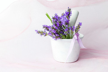 Lavender flowers in a white mortar