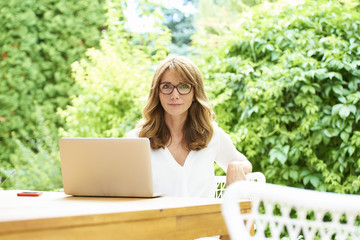 Happy mature woman with laptop
