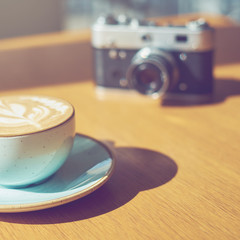drink background of morning coffey in cafe at sunny day with analog camera on table
