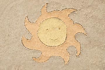 sun drawing in sand