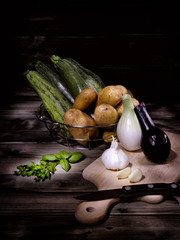 Set of mixed vegetables on aged wooden table