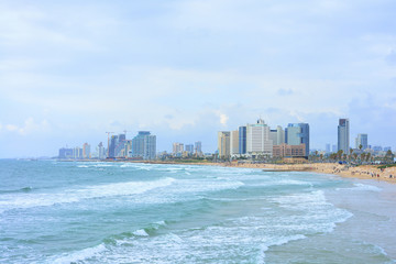 TEL AVIV, ISRAEL - APRIL, 2017: View of the coastline of Tel Aviv in cloudy weather. Famous tourist view, overview