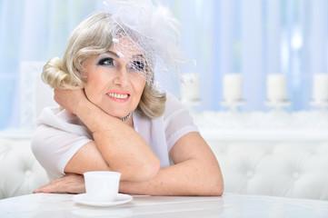 Portrait of a beautiful fashionable elderly woman