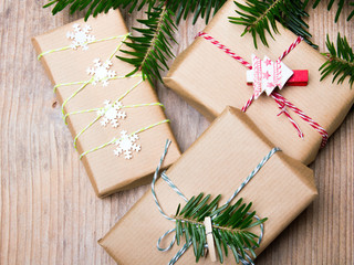 Christmas presents on wooden background, retro style with copy space