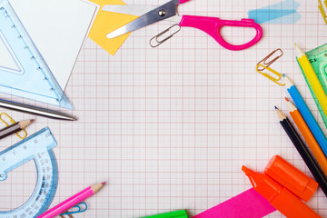 School background with colorful accessories frame