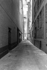 Pathway between two big brick city buildings