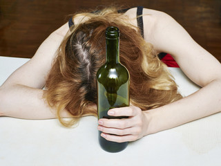 drunk woman with bottle of wine