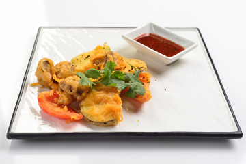 Baked vegetables in batter. White background, menu concept.