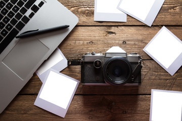 Vintage photo camera. Blank photo frames.